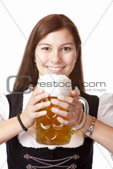 Portrait of happy Bavarian woman with Oktoberfest beer stein.