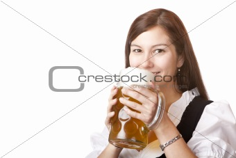 Beautiful woman in dirndl cloth holds Oktoberfest beer stein