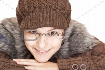 Beautiful young smiling woman with knit hat smiles happy