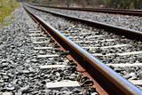 iron rusty train railway detail over dark stones