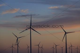 Wind energy turbines at sunset