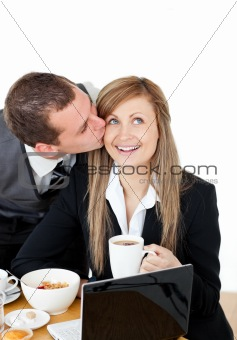 Attractive businessman kissing his bright girlfriend