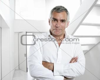 gray hair businessman interior white office