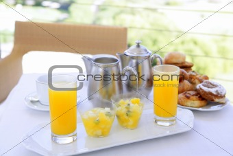 Breakfast with orange juice coffe tea milk