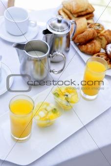 Breakfast with orange juice coffe tea milk