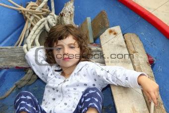 little girl having rest on traditional balearic boat