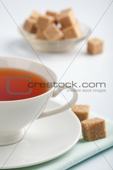 cup of tea and cane sugar
