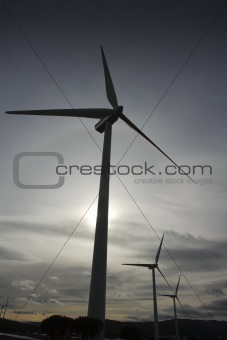 aerogenerator electric windmill cloudy sky