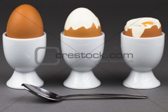 three eggs with spoon