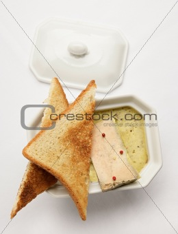 Foie Gras with toasts on the white tablecloth