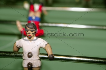 aged table football player macro detail