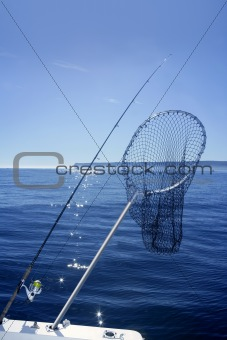 Fishing scoop net on boat in blue sea