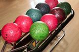 Bowling balls red green closeup row