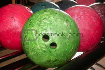 Bowling balls red green closeup row