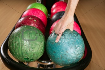 Bowling ball in player man hand