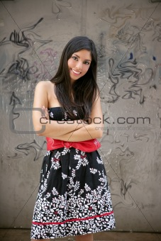 Beautiful brunette urban woman on city graffiti