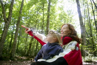 Beautiful blond little daughter mum in the forest