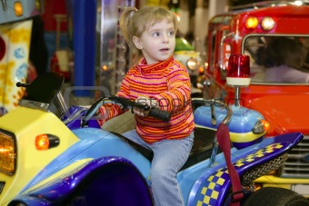 blond little girl in funfair fairground attraction