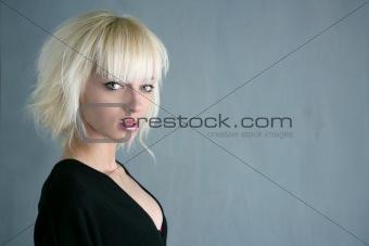 blonde beautiful fashion girl gray background