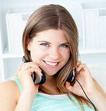 Smiling girl with headphones at home