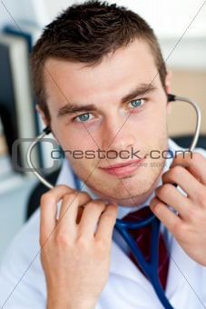 Portrait of an self-assured male doctor holding a stethoscope