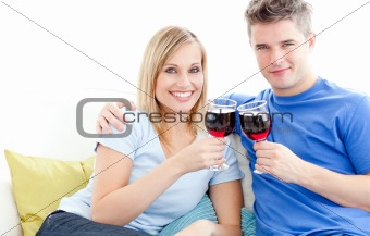 Cute couple drinking wine together in the living-room