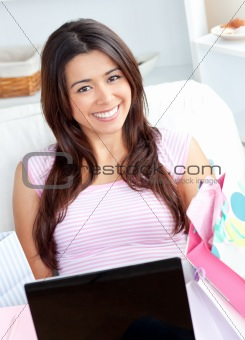 Cute young woman is using a laptop