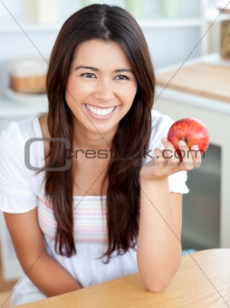 Attractive young woman holding a red an apple