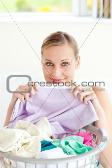 Cute young woman doing housework