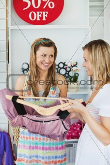 Attractive women choosing clothes together