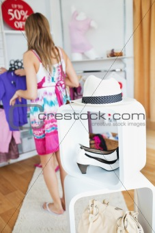Cute woman selecting clothes
