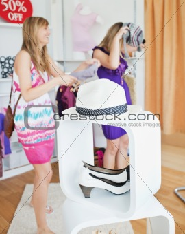 Beautiful women choosing clothes together