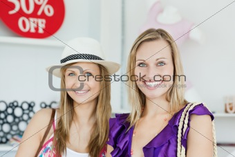 Cute women choosing clothes together