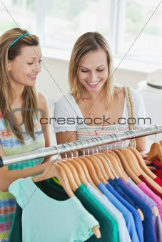 Caucasian women choosing clothes together