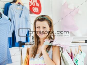 Cute woman choosing clothes