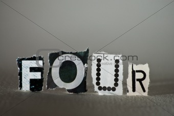 Torn Letters Spelling Out FOUR