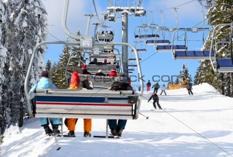 Skiers go on the lift on mountain