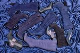 Female blue boots and shoes placed on blue draped satin