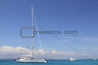 anchored sailboat Formentera turquoise Illetes