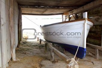 Formentera boat stranded on wooden rails