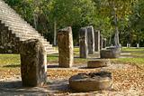 Row of altar stones in front of a contemporary Maya tempel,Tikal