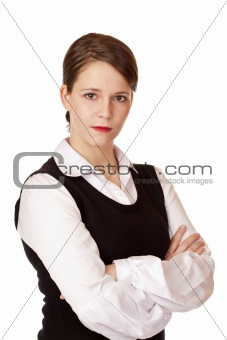 Business woman with crossed arms looks seriously into camera.