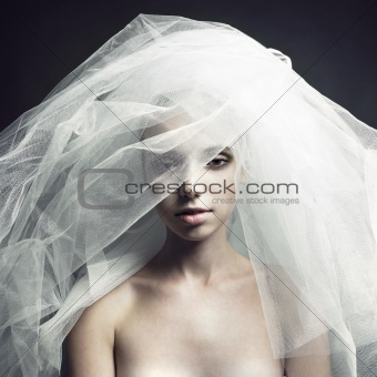 Beautiful girl in a veil