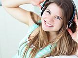 Charming girl listening to music