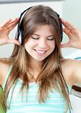 Good-looking girl listening to music