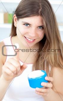 Beautiful girl using cream