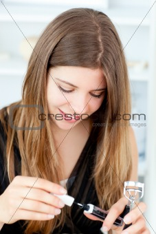 Charming girl using lipstick
