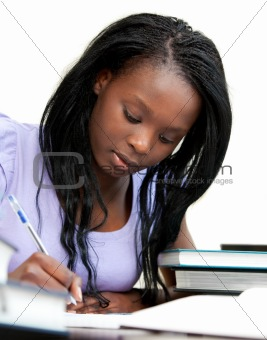 Afro-american woman studying at home