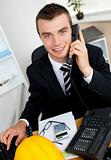 Handsome businessman using phone