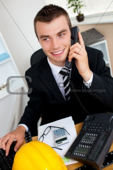 Charming businessman using phone